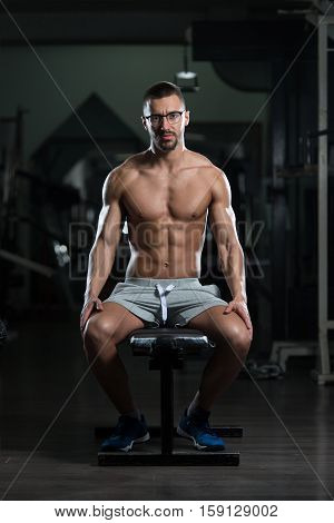 Attractive Young Geek Resting In Gym Afther Exercise