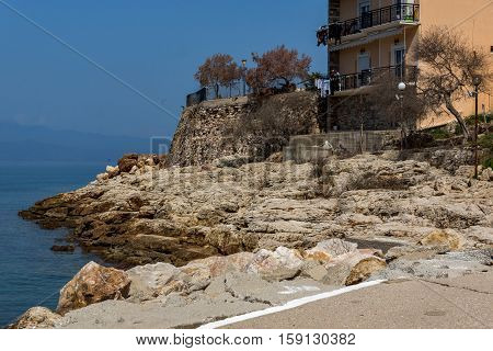 Rocks in the sea on Embankment in Skala Maries, Thassos island, East Macedonia and Thrace, Greece