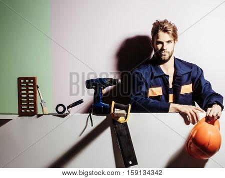 Handsome Man Builder With Tools