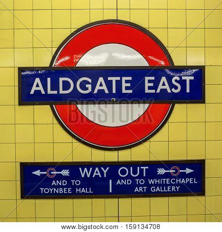 London UK - June 20 2016: logo of the underground station Aldgate East in London. The London Underground is the oldest underground of the world.