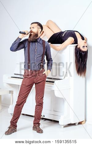 Couple With Microphone And Piano
