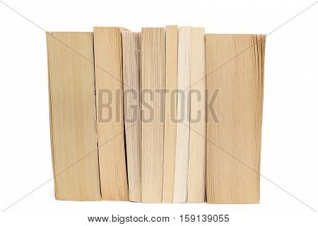 Stack of old paperback books isolated on a white background
