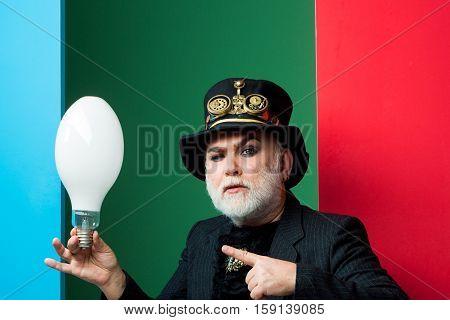 Serious Man Holds Light Bulb