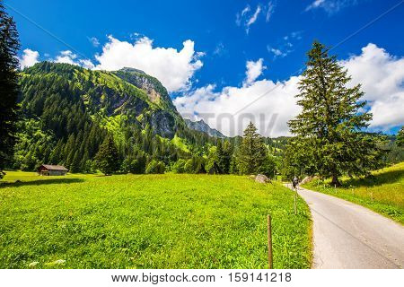 Pathway Leading To Lauenensee Near Gstaad, Berner Oberland, Switzerland, Europe.