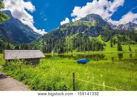 View To Lauenensee Near Gstaad, Berner Oberland, Switzerland, Europe.