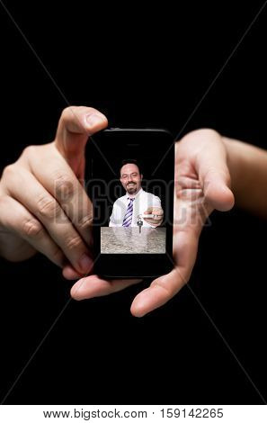 Hands Holding Smartphone showing hotel employee giving your Room keys concept of online Booking (on black background with very shallow depth of field)