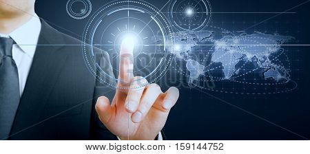 Hand pressing abstract digital button on dark background with map. International businness concept