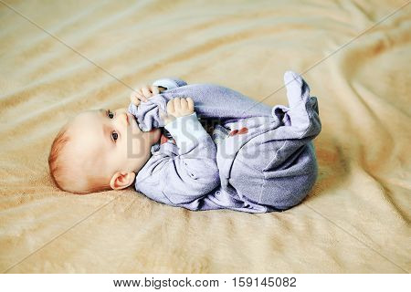 Little Cute Cheerful Baby On Bed