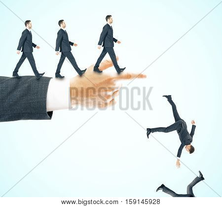 Abstract image of businessmen walking and falling off pointing hand on blue background. Risk and failure concept