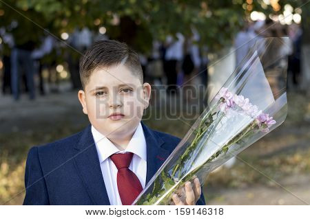 the teenager the school student for September 1 with flowers a subject children and holidays school on September 1