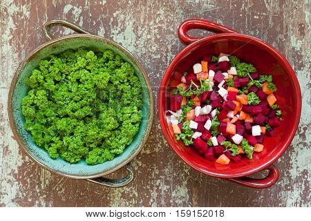 Vegetable soup ingredients in a clay bowl