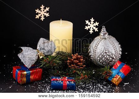 Christmas Or New Year Decoration Background: Fur-tree Branches, Cones, Balls, Candle, Presents And S