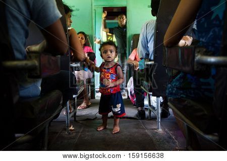 HIKKADUWA SRI LANKA - NOVEMBER 17 : COMMUTERS SITTING IN TRAIN TO COLOMBO NOVEMBER 17 2015 IN HIKKADUWA SRI LANKA