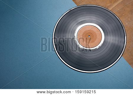 Vinyl Musical Disc On Blue And Wooden Background;