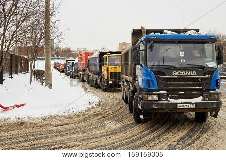 MOSCOW, RUSSIA - JAN 21, 2016: Trucks filled with snow stand at the entrance to the place of processing of the snow.