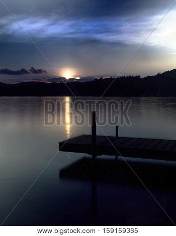 Dock on Squam Lake in New Hampshire at sunset