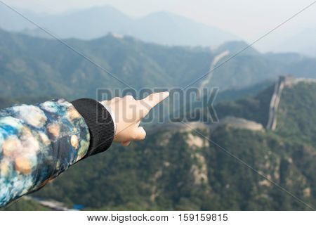 Female Hand Pointing The Great Wall Of China