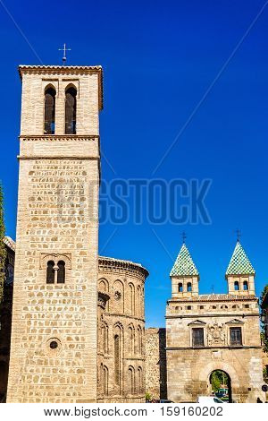 Santiago del Arrabal Church and Puerta de Bisagra Nueva Gate in Toledo - Spain