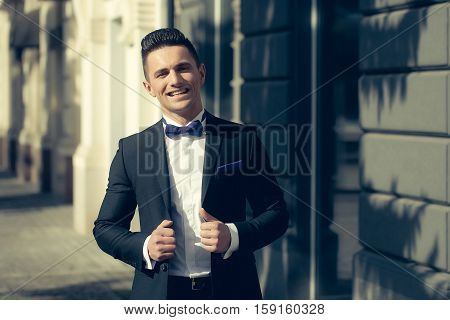 Elegant Man Smiles Outdoor