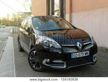 STRASBOURG FRANCE - NOV 29 2016: Black Renault wagon car parked in city. Renault is the bigest French automobile maker