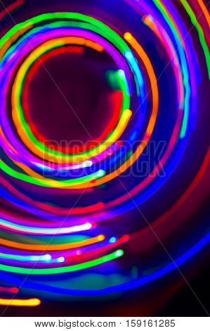 Christmas Tree Lights Spun Around To Achieve A Spiral Glowing Effect; Abstract Circular Color Trails