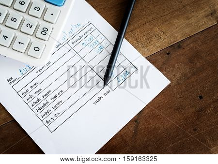 Utility bill with calculator and pencil Save money concept still life style