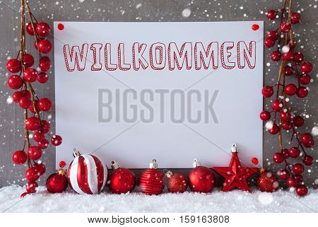 Label With German Text Willkommen Means Welcome. Red Christmas Decoration Like Balls On Snow. Urban And Modern Cement Wall As Background With Snowflakes.