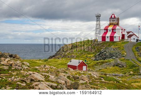 Lighthouse station LL 449, tip of the cape on the Atlantic Ocean, Navigational aid to ships.  Beacon at end of rocky shoreline at the end of the cape.