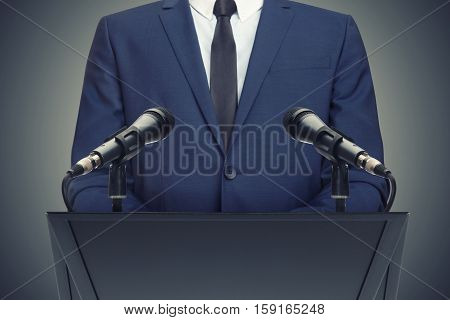 Businessman Or Politician Making Speech Behind The Pulpit