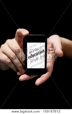 Hands Holding Smartphone, Showing  The Word  Education Printed