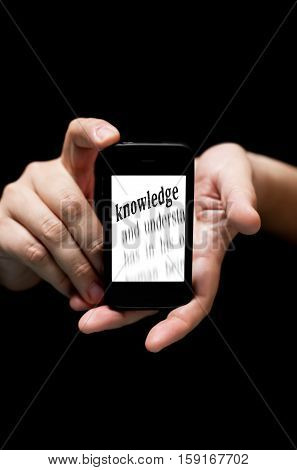 Hands Holding Smartphone, Showing  The Word Knowledge Printed