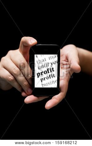Hands Holding Smartphone, Showing  The Word Profit Printed