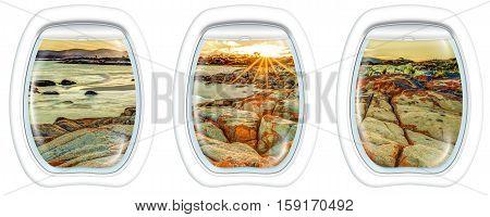 Three plane windows on Bay of Fires, east coast of Tasmania in Australia, from a plane on the porthole windows. Copy space.