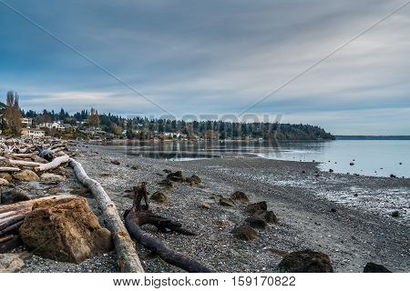 The waters of the Puget Sound are calm along the shoreline of Normandy Park Washington.