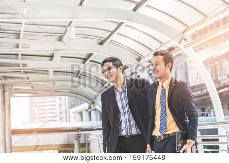 Two Businessman Dicussing Business In Central Of City. Concept Of Modern Business