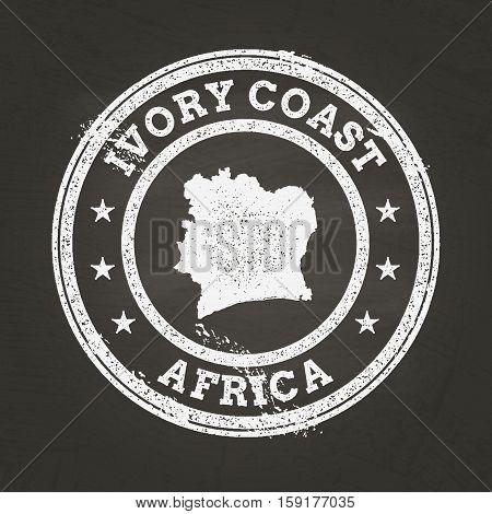 White Chalk Texture Grunge Stamp With Republic Of Ivory Coast Map On A School Blackboard. Grunge Rub