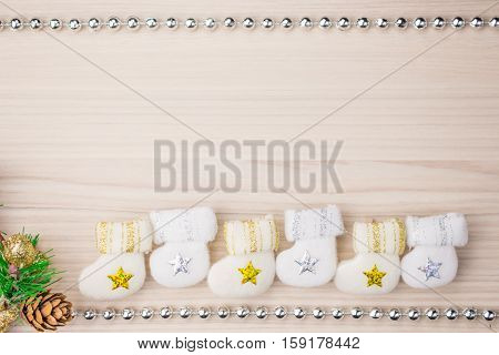 Christmas background boots bump composition with a smile the boots of Santa pine cone on a wooden boards background