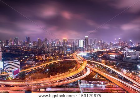 Bangkok cityscape night view with twilight sky expressway and highway top view Thailand