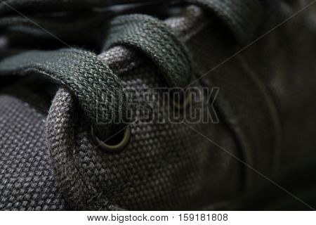 close-up hole shoelace a gray boots/vintage style.