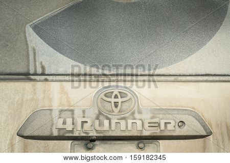 BURNS, CO, USA - NOVEMBER 27, 2016:  Back door of  Toyota 4Runner SUV (2016 Trail edition) during winter travel in dirt roads in Colorado backcountry.