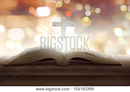 Open Holy Bible With Wooden Cross In The Middle