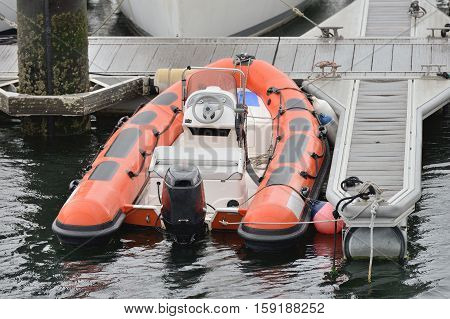 inflatable motor boats moored at the pier