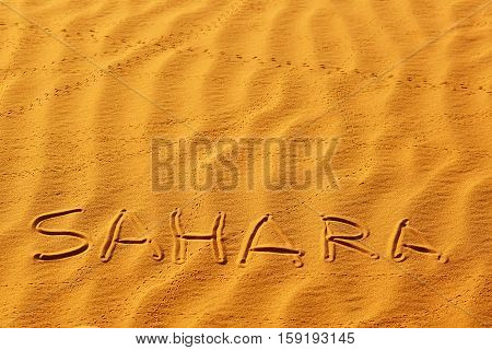 Word Sahara Written On The Sand