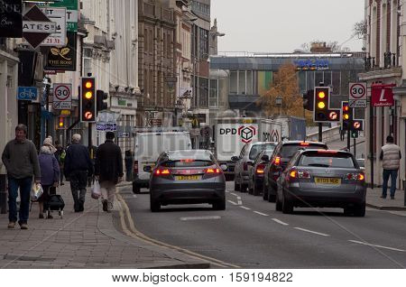 BEDFORD, ENGLAND, UK - Dec 3, 2013: Traffic and pedestrians in the High Street in Bedford England UK.