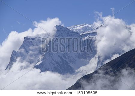 The Everest Himalaya in Nepal with Mount Nup La swathed in cloud.