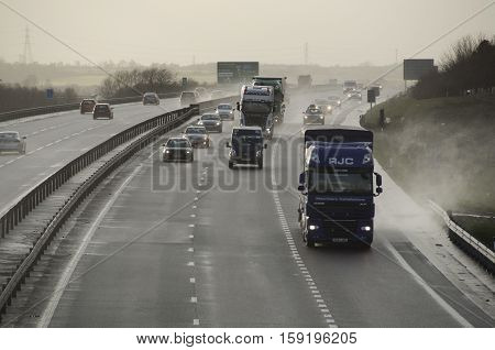 BEDFORD, ENGLAND, UK - February 12, 2014: Hazardous conditions on the busy A421 near Bedford England UK this afternoon as high winds from a large Atlantic storm caused travel chaos on Britain's roads.