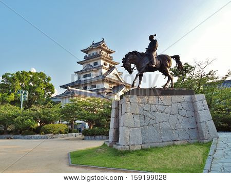 Ehime, Japan - July 20, 2016: Statue of Todo Takatora and his castle - Imabari Castle. Imabari Castle is a Japanese castle in Imabari, Ehime Prefecture, Japan. This castle is well known as one of the three water castles in Japan.