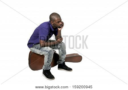 Handsome young black man with a acoustic guitar case