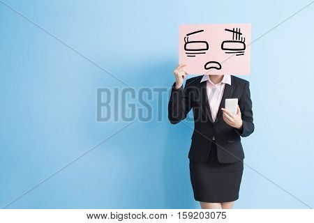 business woman with tired billboard and use smart phone isolated blue background