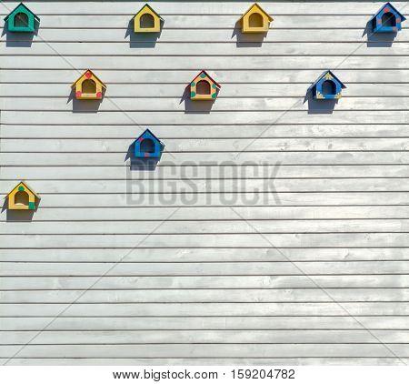 Nesting boxes for birds on wooden planks